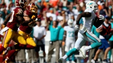 LANDOVER, MD - SEPTEMBER 13: Wide receiver Jarvis Landry #14 of the Miami Dolphins carries the ball for a second half touchdown during a game against the Washington Redskins at FedExField on September 13, 2015 in Landover, Maryland. (Photo by Patrick Smith/Getty Images)